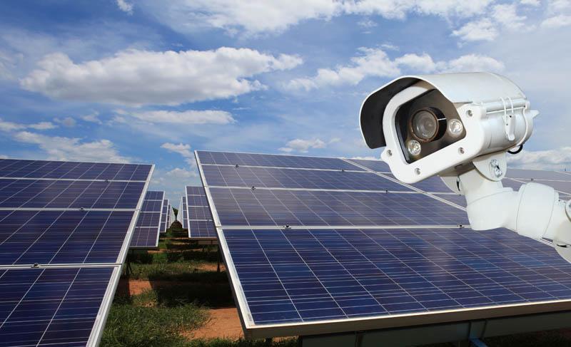 security camera by solar farm